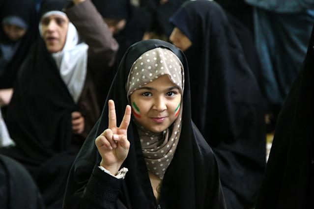 <p>A girl gestures as Senior Iranian cleric Ahmad Khatami conducts Friday sermon (Khutbah) during Friday prayer in Tehran, Iran on Jan. 5, 2018. (Photo: Fatemeh Bahrami/Anadolu Agency/Getty Images) </p>
