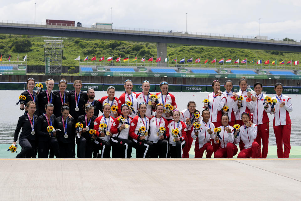 Gold medalists team Canada, center, silver medalist team New Zealand, left, and bronze medalists team Austria pose during the medal ceremony for the women's rowing single sculls final at the 2020 Summer Olympics, Friday, July 30, 2021, in Tokyo, Japan. (AP Photo/Lee Jin-man)