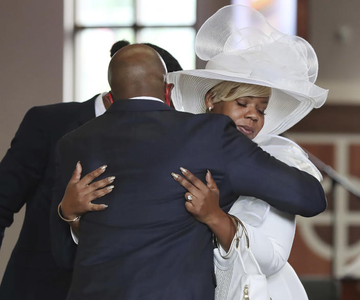 The Rev. Raphael G. Warnock, senior pastor of Ebenezer Baptist Church comforts Tomika Miller, the wife of Rayshard Brooks, during his public viewing at Ebenezer Baptist Church on Monday, Jun 22, 2020 in Atlanta. Brooks, 27, died June 12 after being shot by an officer in a Wendy's parking lot. Brooks' death sparked protests in Atlanta and around the country. A private funeral for Brooks will be held Tuesday at the church. (Curtis Compton/Atlanta Journal-Constitution via AP, Pool)
