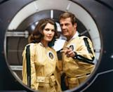 <p>Roger Moore and actress Lois Chiles on the set of Moonraker.</p>