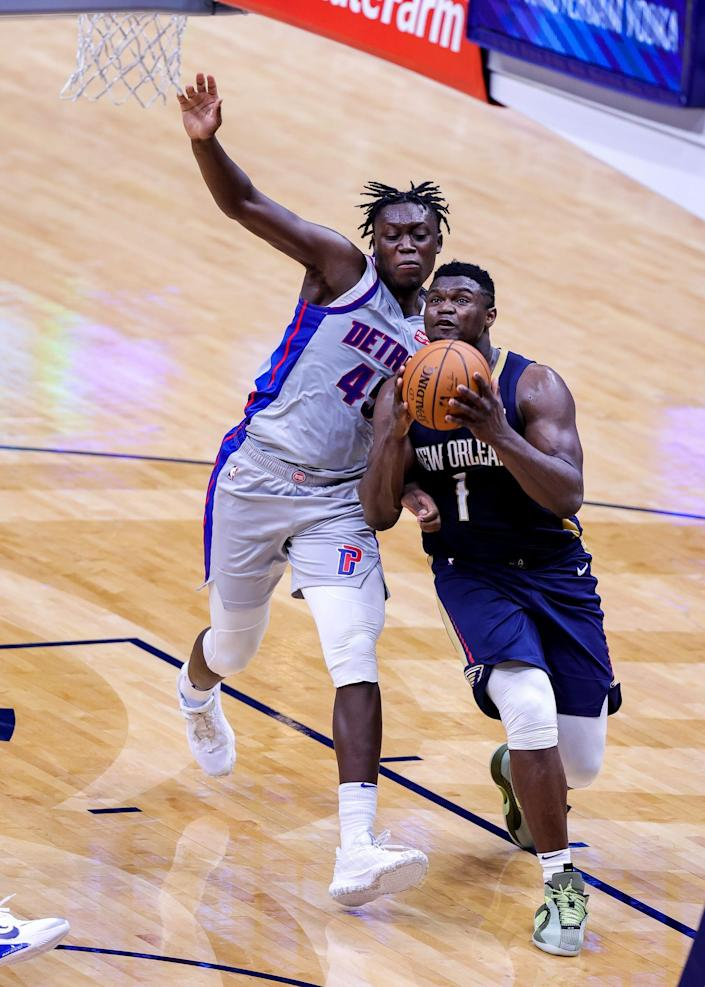 Pelicans forward Zion Williamson drives to the basket against Pistons forward Sekou Doumbouya during the second half of the Pistons' 128-118 loss to the Pelicans in New Orleans on Wednesday, Feb. 24, 2021.