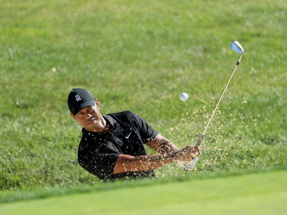 Tiger Woods plays in a practice round at Muirfield Village (Getty)