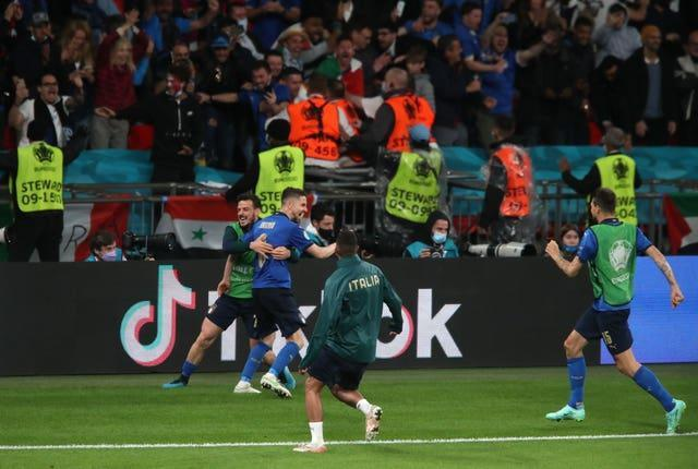 Italy's Jorginho celebrates scoring the winning penalty in the semi-final against Spain at Wembley