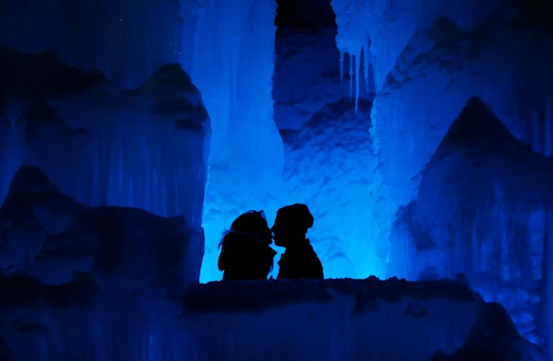 "A couple enjoy the Ice Castles in North Woodstock, N.H. ""It's a really popular date night spot,"" said castle builder Matt Pasciuto. ""I can't tell you how many marriage proposals I've seen so far in the castle."" (Photo: Robert F. Bukaty/AP)"