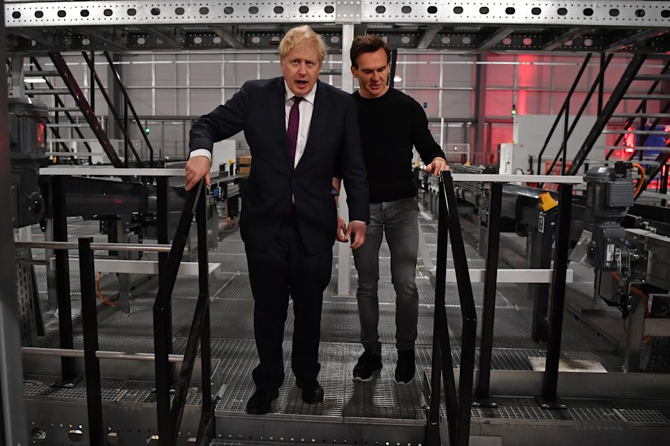 UK prime minister Boris Johnson with The Hut Group (THG) founder Matthew Moulding during a visit to a fulfillment centre. Photo: Ben Stansall/WPA Pool/Getty Images