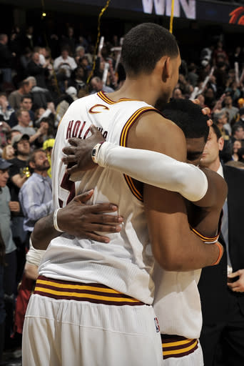 CLEVELAND, OH - FEBRUARY 19: Kyrie Irving #2 of the Cleveland Cavaliers receives a congratulatory hug from teammate Ryan Hollins #5 after securing the win over the Sacramento Kings with two late free throws at The Quicken Loans Arena on February 19, 2012 in Cleveland, Ohio. (Photo by David Liam Kyle/NBAE via Getty Images)