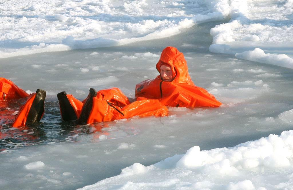 "Brrrrr! As part of his Walking with the Wounded charity expedition in the arctic, Prince Harry went for a swim in an immersion suit while on the island of Spitsbergen, which is situated between the Norwegian mainland and the North Pole. The crew has been practicing their survival techniques during their last days of preparation before setting off to the North Pole on foot. David Cheskin/WPA Pool/<a href=""http://www.gettyimages.com/"" target=""new"">GettyImages.com</a> - March 30, 2011"