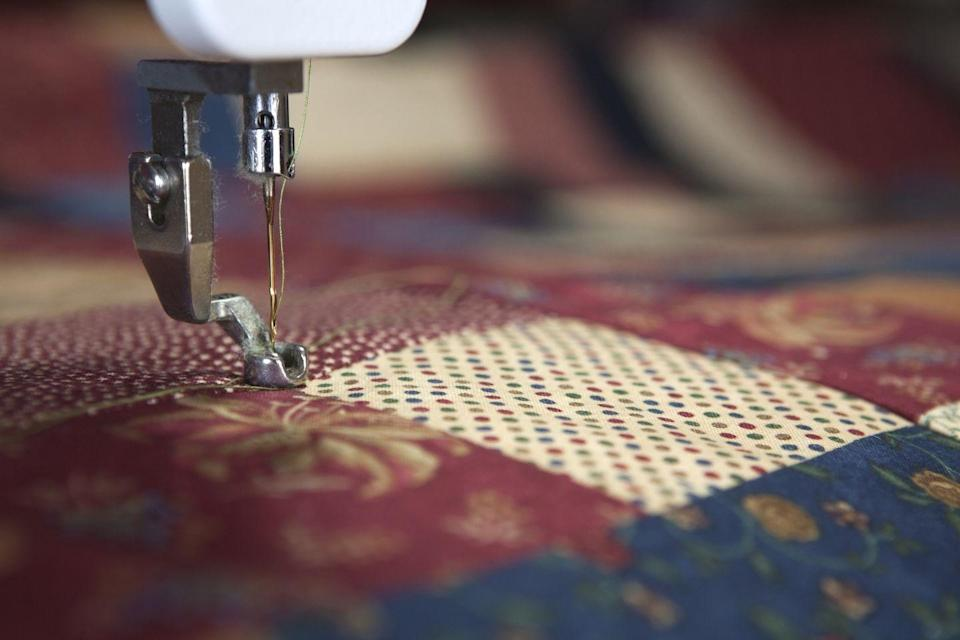"""<p>Keep Mom cozy and warm with a handmade quilt. Pick up fabrics in her favorite color at your local craft store or repurpose old t-shirts to make a quilt that's filled with memories. </p><p><a class=""""link rapid-noclick-resp"""" href=""""https://www.amazon.com/CiaraQ-Sewing-Polyester-Machine-Embroidery/dp/B06XRF1LCM/ref=sr_1_3?dchild=1&keywords=sewing+thread&qid=1605821439&sr=8-3&tag=syn-yahoo-20&ascsubtag=%5Bartid%7C10063.g.34832092%5Bsrc%7Cyahoo-us"""" rel=""""nofollow noopener"""" target=""""_blank"""" data-ylk=""""slk:SHOP THREAD"""">SHOP THREAD</a></p>"""