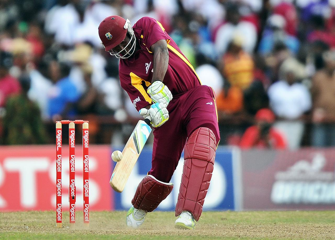 West Indies cricketer Andre Russell hits a boundary off Australian bowler Clint McKay during the third-of-five One Day International (ODI) matches between West Indies and Australia at the Arnos Vale Ground in Kingstown on March 20, 2012. Australia have scored 220/10 at the end of their innings. AFP PHOTO/Jewel Samad (Photo credit should read JEWEL SAMAD/AFP/Getty Images)