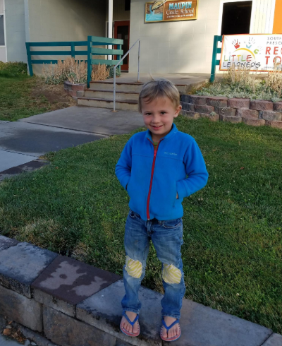 Max Carver stands outside of a preschool.