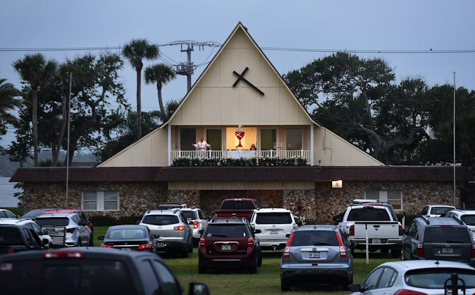 """<span class=""""caption"""">Car horns mark 'amens' at drive-in church services, such as this one in Daytona Beach, Florida.</span> <span class=""""attribution""""><a class=""""link rapid-noclick-resp"""" href=""""https://www.gettyimages.com/detail/news-photo/people-in-cars-attend-easter-sunday-services-at-the-daytona-news-photo/1209761916?adppopup=true"""" rel=""""nofollow noopener"""" target=""""_blank"""" data-ylk=""""slk:Paul Hennessy/SOPA Images/LightRocket via Getty Images"""">Paul Hennessy/SOPA Images/LightRocket via Getty Images</a></span>"""