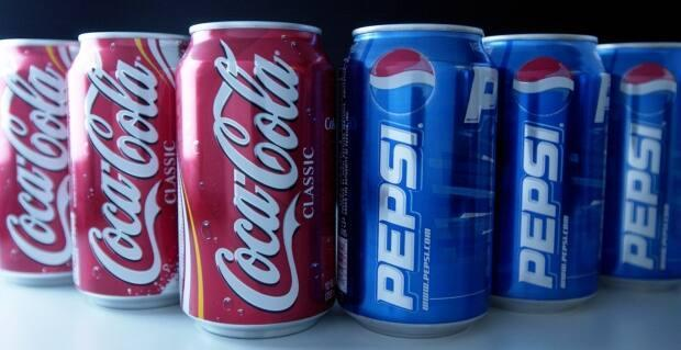The new Newfoundland and Labrador budget paves the way for a new tax on drinks sweetened with sugar, like Coke and Pepsi.  (Daniel Acker/Bloomberg News - image credit)