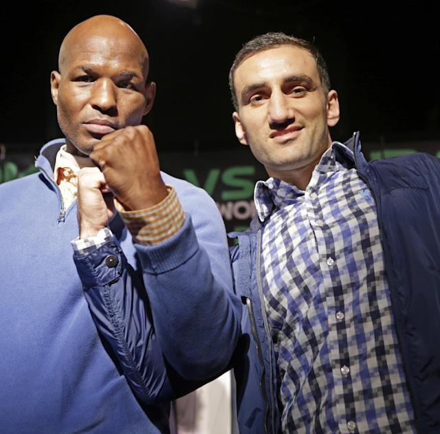 Boxers Bernard Hopkins, left, and challenger Karo Murat of Germany, pose for photographers during a news conference, Wednesday, Oct. 23, 2013, in New York. Hopkins, 48, seeks to become the oldest fighter in history to defend a title when he faces Murat on Saturday in Atlantic City, N.J., for the Hopkins' IBF light heavyweight title. (AP Photo/Kathy Willens)