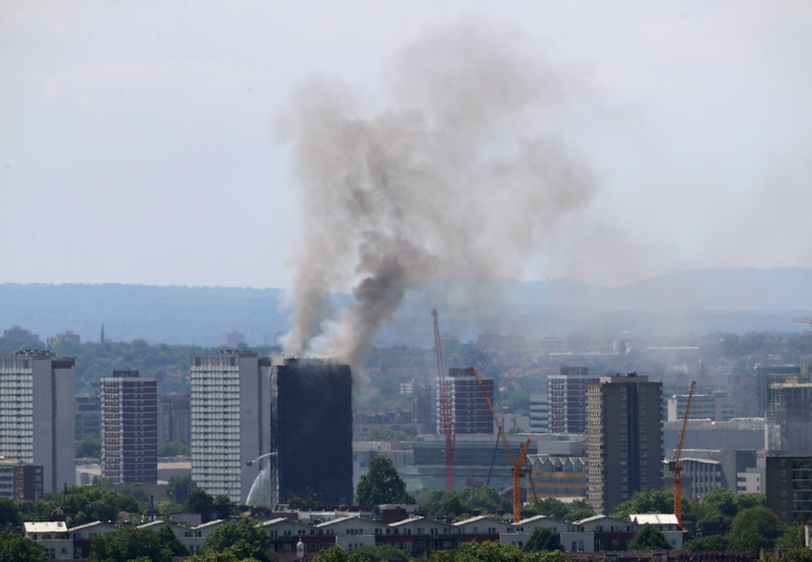 Smoke is still billowing over 12 hours since the fire started (PA)