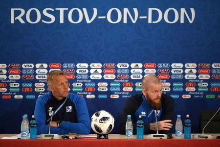 Soccer Football - World Cup - Iceland Press Conference - Rostov Arena, Rostov-on-Don, Russia - June 25, 2018 Iceland coach Heimir Hallgrimsson and Iceland's Aron Gunnarsson during the press conference REUTERS/Marko Djurica