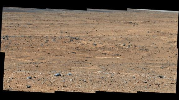 """An outcrop visible as light-toned streaks in the lower center of this image has been chosen as a place for NASA's Mars rover Curiosity to study for a few days in September 2013. The pause for observations at this area, called """"Waypoint 1,"""" is"""