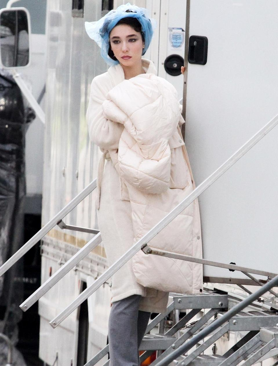 <p>Matilda De Angelis leaves her trailer to film scenes for her latest movie <em>Robbing Mussolini</em> in Rome on Tuesday.</p>