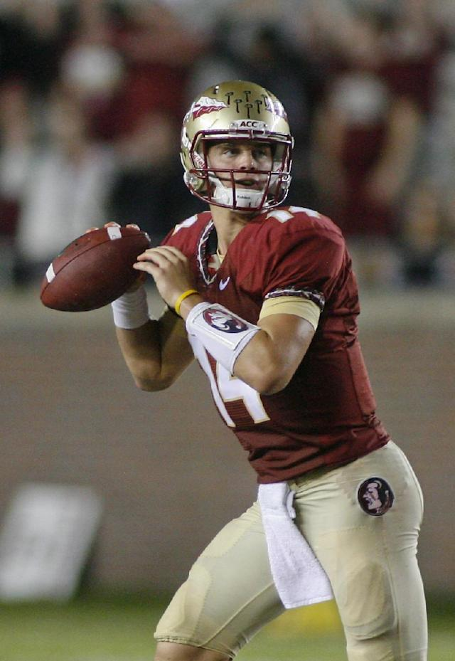 Florida State quarterback Jacob Coker (14) looks for a receiver in the fourth quarter of an NCAA college football game against Bethune-Cookman on Saturday, Sept. 21, 2013, in Tallahassee, Fla. Florida State beat Bethune-Cookman 54-6. (AP Photo/Phil Sears)