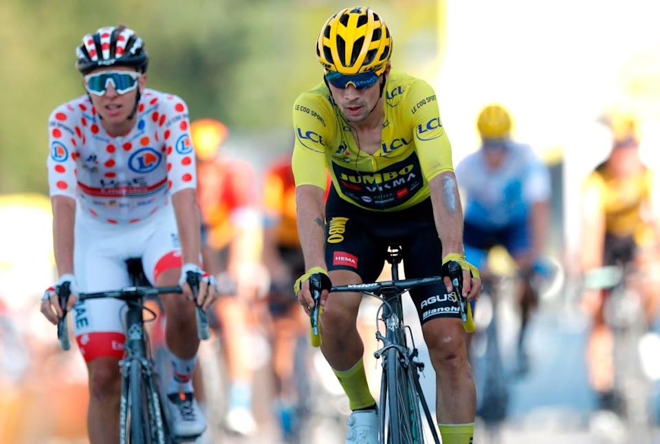 Team UAE Emirates rider Slovenias Tadej Pogacar wearing the best climbers polka dot jersey L and Team Jumbo rider Slovenias Primoz Roglic wearing the overall leaders yellow jersey cross the finish line at the end of the 18th stage of the 107th edition of the Tour de France cycling race 168 km between Meribel and La Roche sur Foron on September 17 2020 Photo by STEPHANE MAHE  POOL  AFP Photo by STEPHANE MAHEPOOLAFP via Getty Images