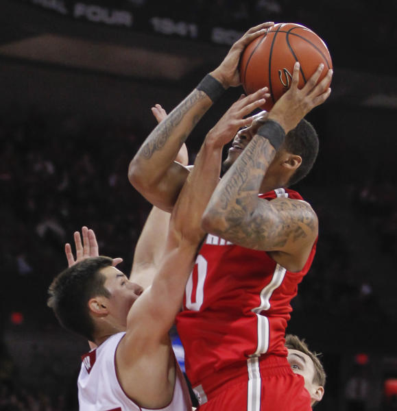 Wisconsin's Bronson Koenig, left, fouls Ohio State's LaQuinton Ross during the first half of an NCAA college basketball game Saturday, Feb. 1, 2014, in Madison, Wis. (AP Photo/Andy Manis)