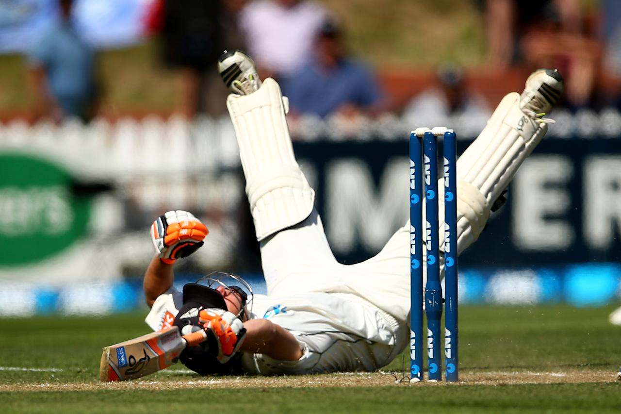 WELLINGTON, NEW ZEALAND - FEBRUARY 16: BJ Watling of New Zealand dives to make his crease during day three of the 2nd Test match between New Zealand and India at the Basin Reserve on February 16, 2014 in Wellington, New Zealand.  (Photo by Phil Walter/Getty Images)