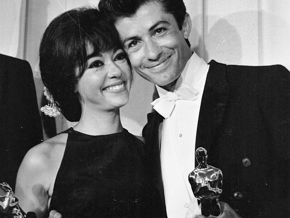 Rita Moreno and George Charkis hold their OscarsGetty Images