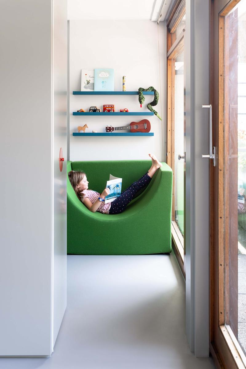 The movable furniture can be pulled out into the bedroom, which is partitioned off from the living area by a sliding door. Talk about ingenious.