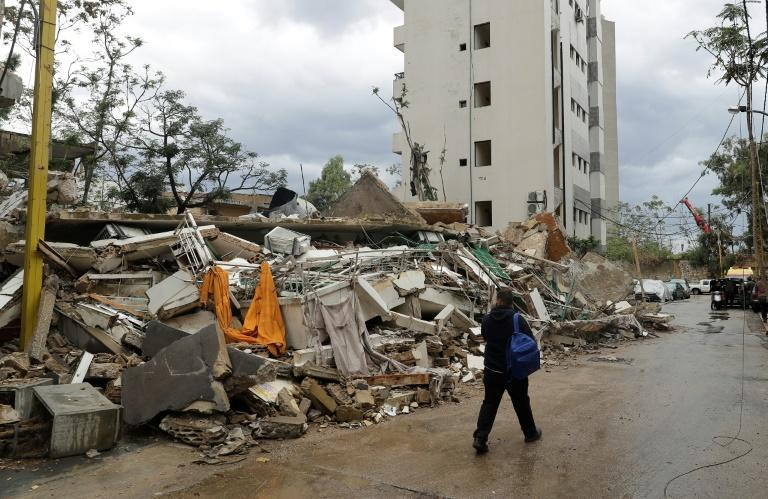 A man walks past a building in Beirut's Karantina neighbourhood that was damaged by the August 4 port blast and collapsed due to heavy rain