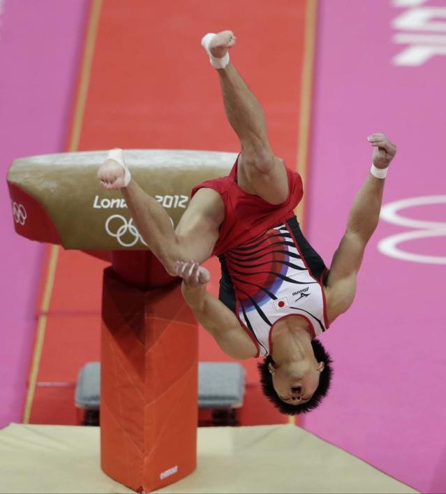 Japanese gymnast Koji Yamamuro fails his vault jump during the Artistic Gymnastic men's team final at the 2012 Summer Olympics, Monday, July 30, 2012, in London. (AP Photo/Gregory Bull)