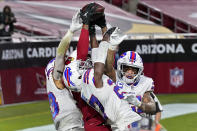 Arizona Cardinals wide receiver DeAndre Hopkins catches the game-winning touchdown as Buffalo Bills cornerback Tre'Davious White, center, free safety Jordan Poyer, right, and strong safety Micah Hyde, left, defend during the second half of an NFL football game, Sunday, Nov. 15, 2020, in Glendale, Ariz. The Cardinals won 32-20. (AP Photo/Ross D. Franklin)