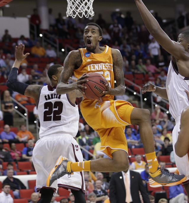 Tennessee guard Jordan McRae (52) shoots against Massachusetts forward Sampson Carter (22) during the second half of an NCAA college basketball second-round tournament game, Friday, March 21, 2014, in Raleigh, N.C. (AP Photo/Chuck Burton)