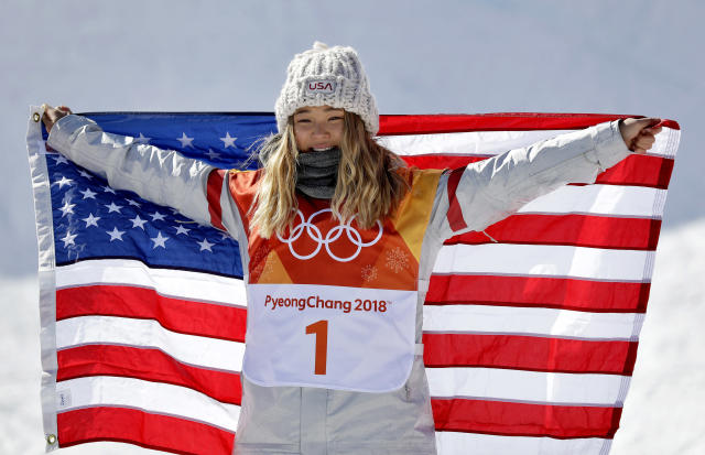 ChloeKim, of the United States, celebrates winning gold in the women's halfpipe finals at Phoenix Snow Park at the 2018 Winter Olympics in Pyeongchang, South Korea, Tuesday, Feb. 13, 2018. (AP Photo/Gregory Bull)