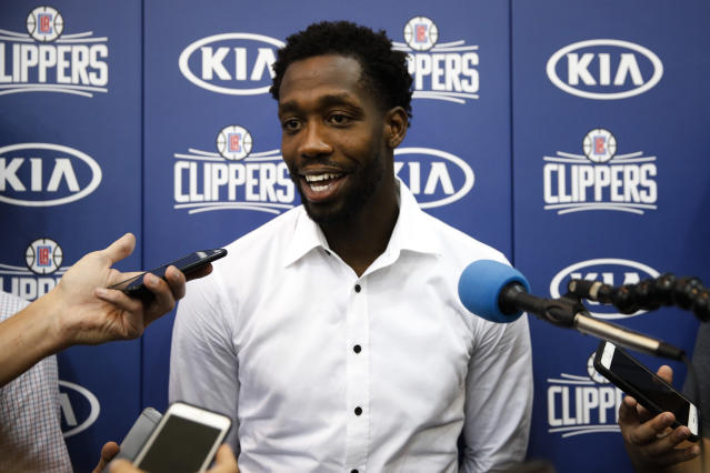 "<a class=""link rapid-noclick-resp"" href=""/nba/players/4647/"" data-ylk=""slk:Patrick Beverley"">Patrick Beverley</a> gets comfortable in front of the microphone. (AP)"