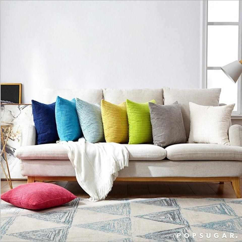 "<p>Get this set of two <a href=""https://www.popsugar.com/buy/Tanvir-18-Throw-Pillows-567257?p_name=Tanvir%2018%22%20Throw%20Pillows&retailer=wayfair.com&pid=567257&price=42&evar1=casa%3Aus&evar9=45784601&evar98=https%3A%2F%2Fwww.popsugar.com%2Fhome%2Fphoto-gallery%2F45784601%2Fimage%2F47575724%2FTanvir-18-Throw-Pillow&list1=shopping%2Cproducts%20under%20%2450%2Cdecor%20inspiration%2Caffordable%20shopping%2Chome%20shopping&prop13=api&pdata=1"" class=""link rapid-noclick-resp"" rel=""nofollow noopener"" target=""_blank"" data-ylk=""slk:Tanvir 18&quot; Throw Pillows"">Tanvir 18"" Throw Pillows</a> ($42) in your favorite color.</p>"