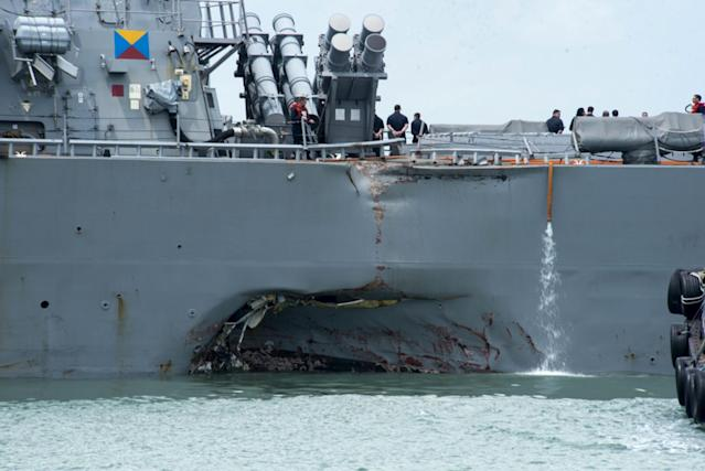 "<p>Damage to the portside is visible as the Guided-missile destroyer USS John S. McCain (DDG 56) steers towards Changi naval base in Singapore following a collision with the merchant vessel Alnic MC Aug. 21, 2017. The USS John S. McCain was docked at Singapore's naval base with ""significant damage"" to its hull after an early morning collision with the Alnic MC as vessels from several nations searched Monday for missing U.S. sailors. (Photo: Mass Communication Specialist 2nd Class Joshua Fulton/U.S. Navy photo via AP) </p>"