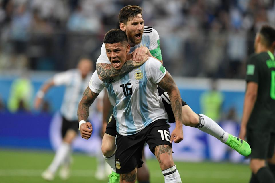 Argentina's defender Marcos Rojo (lower) celebrates his goal with Argentina's forward Lionel Messi during the World Cup Group D football match between Nigeria and Argentina. (Getty)