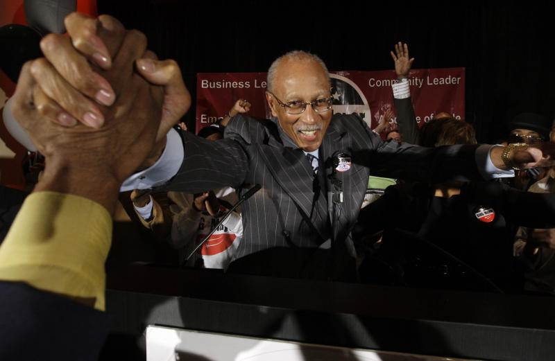 FILE - In this May 5, 2009 file photo Dave Bing celebrates his mayoral victory after winning a special election in Detroit. The former NBA great, who transitioned smoothly to owner and founder of a steel supply company, became Mayor of Detroit in 2009. In basketball and business, he never side-stepped a challenge, but the overwhelming weight of Detroit's financial problems and other troubles have convinced Bing to pass control of the city over to the state. (AP Photo/Paul Sancya, File)