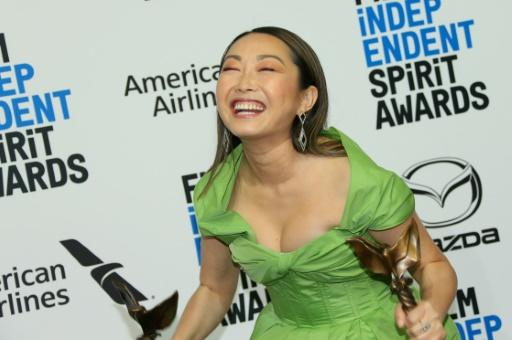 """Lulu Wang, director of """"The Farewell,"""" celebrates winning the best picture category at the Spirit Awards on February 8, 2020"""