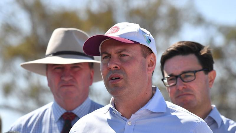 Treasurer Josh Frydenberg (C) is insistent the federal government has an effective drought policy