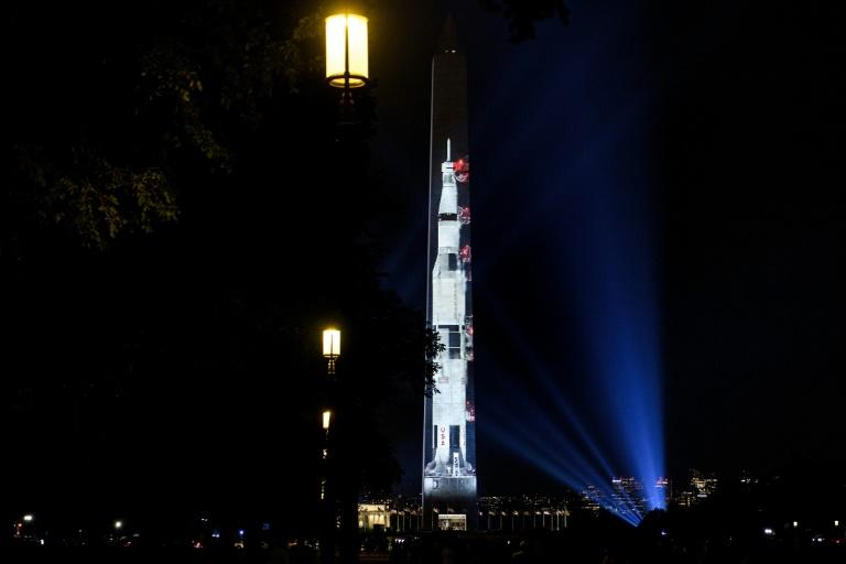 A projection of a Saturn V rocket on the Washington Monument on the National Mall to commemorate the 50th anniversary of NASA's Apollo 11 mission to the moon