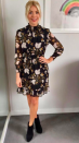 """<p>Holly opted for a dress decked in winter florals by <a rel=""""nofollow noopener"""" href=""""http://www.whistles.com/women/clothing/dresses/belize-print-silk-dobby-dress-26073.html?dwvar_belize-print-silk-dobby-dress-26073_size=04&utm_source=google_shopping&utm_medium=cpc&utm_term=.&utm_campaign=&utm_content=s5Bg7TKTm_dc