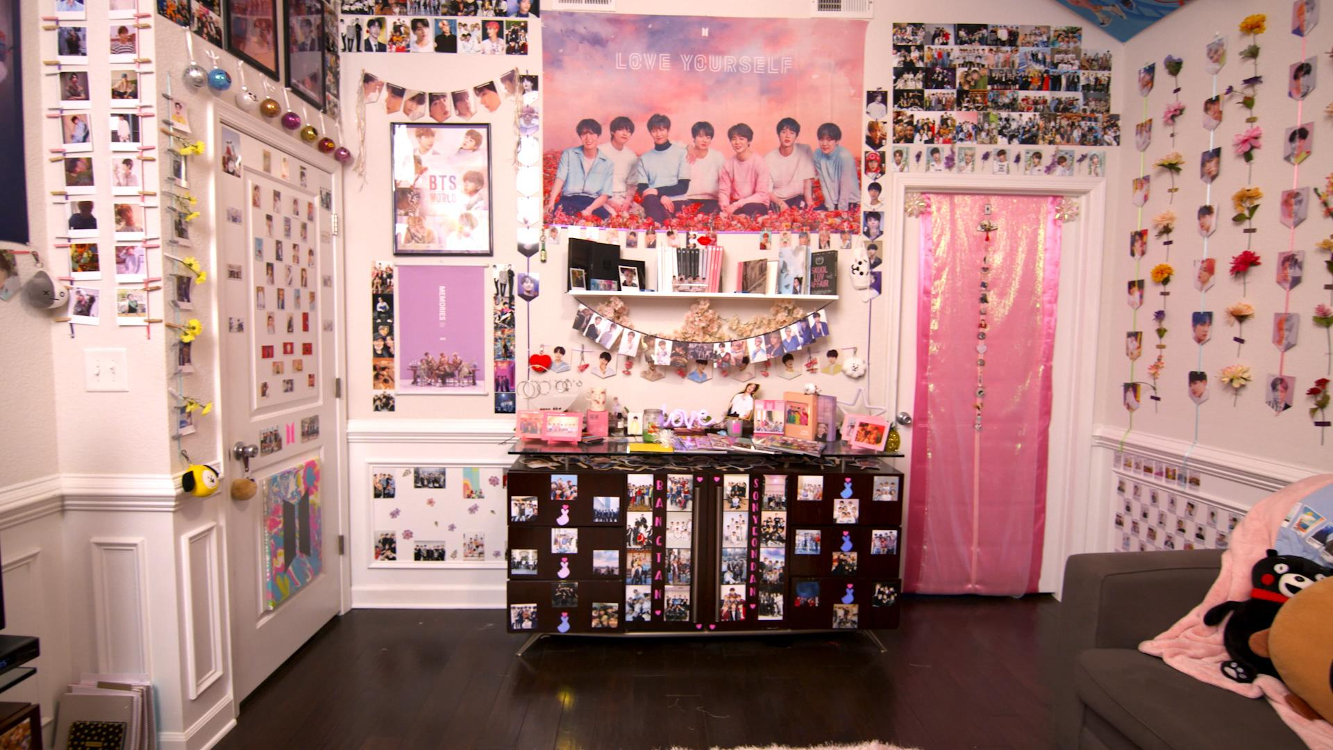 The BTS HQ room consists of hundreds of BTS photos, albums, merch, plushies, and more.