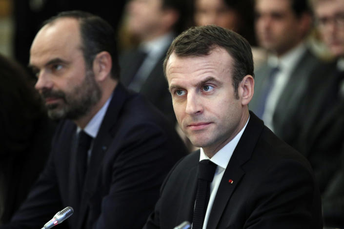 French President Emmanuel Macron, right, and French Prime Minister Edouard Philippe meet with representatives of trade unions, employers' organizations and local elected officials at the Elysee Palace in Paris, Monday, Dec.10 2018. Macron is preparing to speak to the nation Monday at last, after increasingly violent and radicalized protests against his leadership and a long silence that aggravated the anger. (Yoan Valat, Pool via AP)