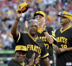 Former Pittsburgh Pirates player Rennie Stennett holds up his hat as he acknowledges the crowd during the 40th anniversary of the 1979 World Series team at PNC Park in Pittsburgh, in this Saturday, July 20, 2019, file photo. In the forground is former Pirates player Manny Sanguillen. Rennie Stennett has died. He was 72. The team, citing information provided by the Stennett family, said Stennett passed away early Tuesday morning, May 18, 2021, following a bout with cancer. (Matt Freed/Pittsburgh Post-Gazette via AP)