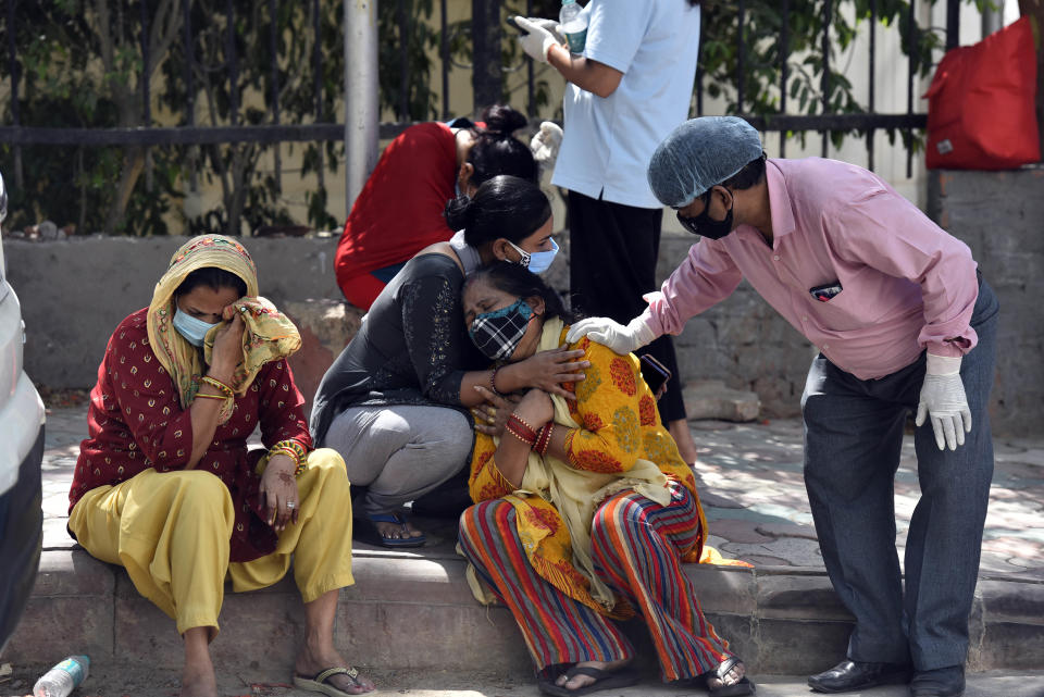 NEW DELHI, INDIA  APRIL 25: Grieving relatives and family members of Covid victims wait outside Maulana Azad Medical College mortuary to collect their bodies, on April 25, 2021 in New Delhi, India. (Photo by Sanjeev Verma/Hindustan Times via Getty Images)