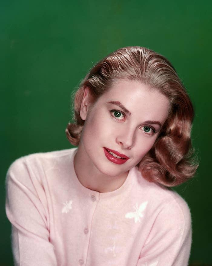 Photo of Grace Kelly in a pink cardigan