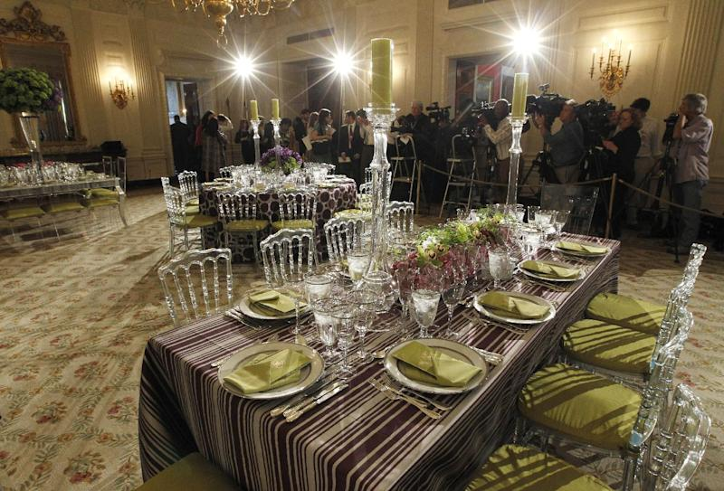 Table settings in the State Dining Room of the White House in Washington, Wednesday, March 14, 2012, ahead of tonight's State Dinner hosted by President Barack Obama and first lady Michelle Obama for British Prime Minister David Cameron and his wife Samantha. (AP Photo/Pablo Martinez Monsivais)