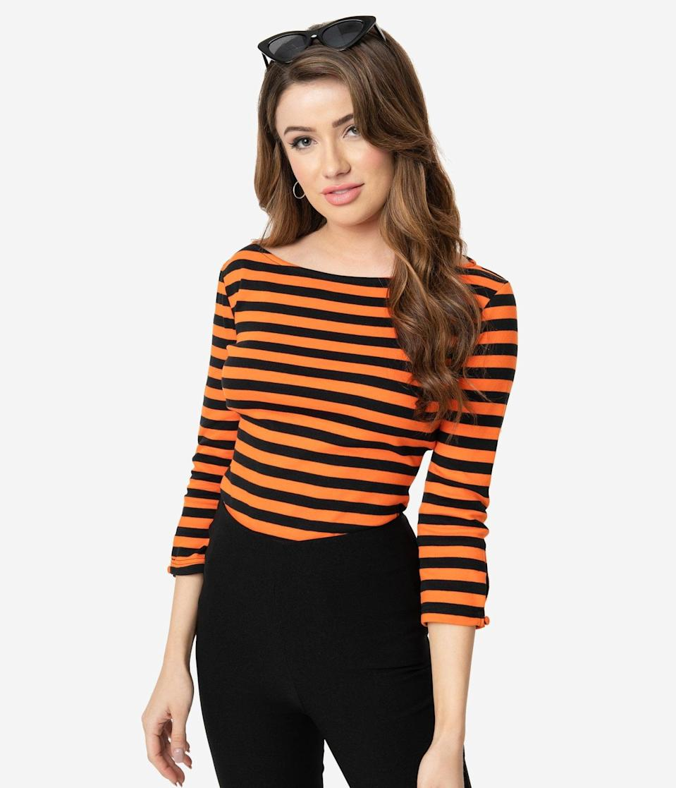 "<p>You'll look like the epitome of <a class=""link rapid-noclick-resp"" href=""https://www.popsugar.com/Halloween"" rel=""nofollow noopener"" target=""_blank"" data-ylk=""slk:Halloween"">Halloween</a> with this <span>Unique Vintage Black and Orange Stripe Knit Three-Quarter Sleeve Gracie Top</span> ($58).</p>"
