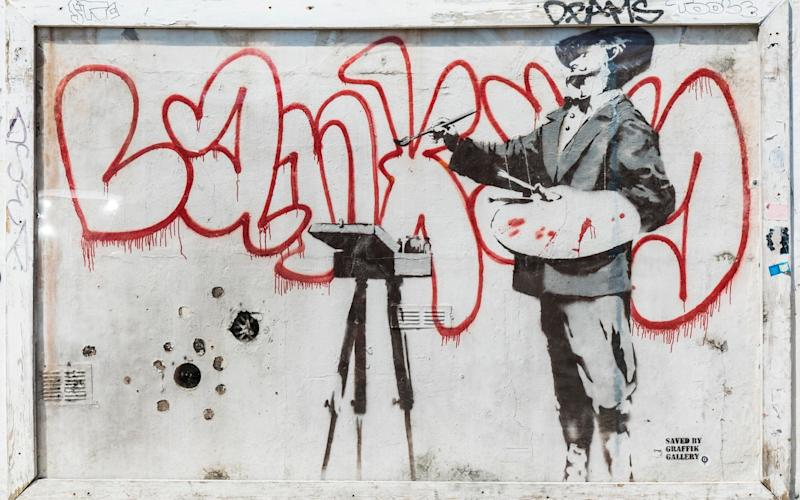 This Banksy piece, from the side of a house in West London, is being relocated to a higher part of the same wall in a development called Sartoria House - Copyright © Grant Frazer