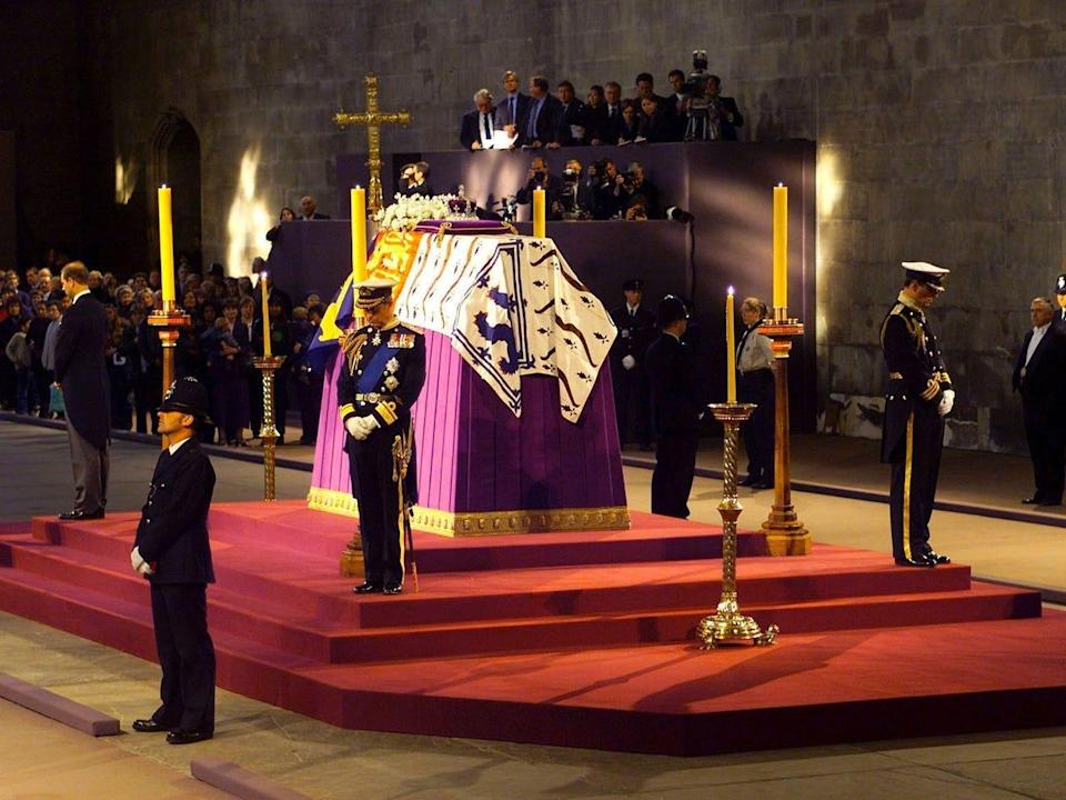 Prince Charles stands in vigil at the coffin of his grandmother, the queen mother, on April 8, 2002, in Westminster Hall. Pool Photo/Getty Images